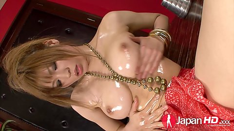 Oiled up and self loving asian chick sucks on dildo