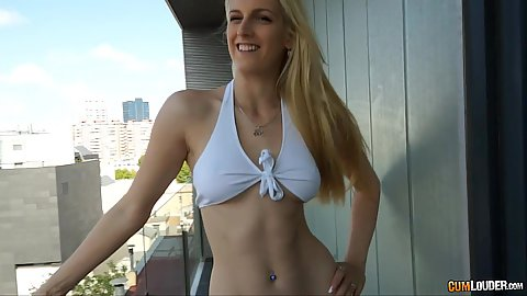 Blonde Mira Sunset goes on the balcony to show some tits and pussy
