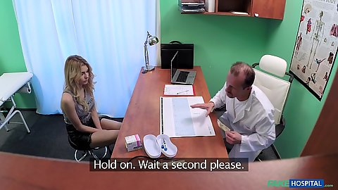 Doctor office visit with blonde getting on desk