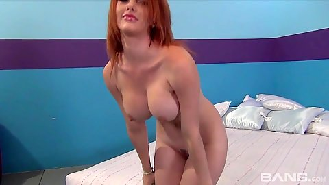 Large chest redhead Lilith Lust stripping naked and climbing on shaft
