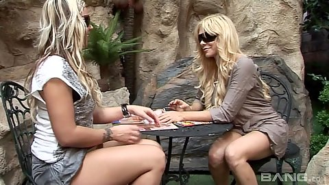 Nice lesbian sluts Robin Truelove and Carmel Moore strip naked outdoors and do clit sucking