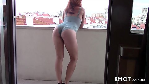 Aurora wearing sexy lingerie and posing on balcony