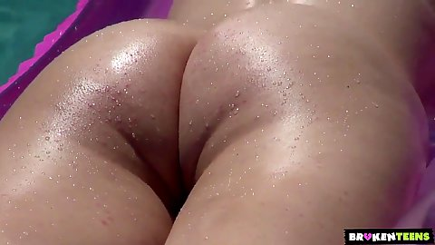 Teen cutie Jonni has a very arousing butt when wet in the pool