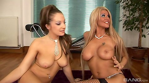 Busty sluts Tia Layne and Cate Harrington kneel to suck dick