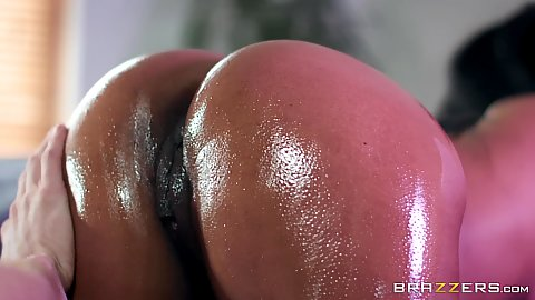 Super bombshell black booty covered in oil Kiki Minaj all slippery and ready for big white dick