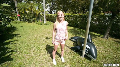 Outdoor playing with petite girl in shorts Aubrey Marie