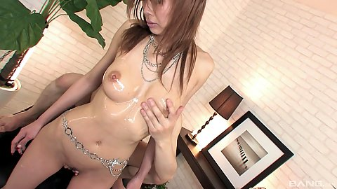 Oiled up glamorous asian girl in the office fingered and vibrated