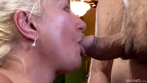 Dick sucking mature Dana Hayes also offering a great booted titty fuck