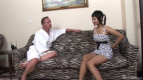Cute asian girl working in massage parlor and talks with client