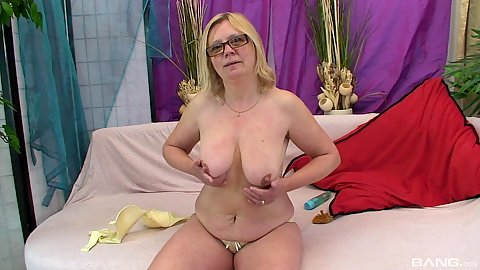 Mature solo in glasses showing her saggy boobies