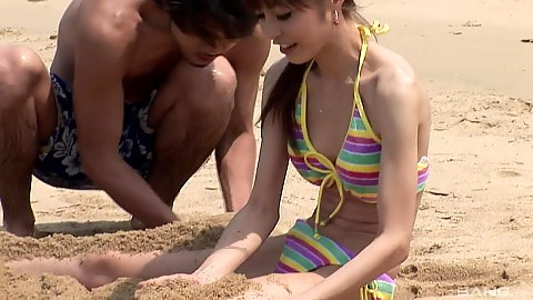 Sensual softcore reality beach play in the sand with cute Japanese girl in bikini