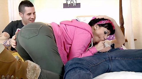 Fully clothed dick blowing Samantha Pink works on two cocks at once