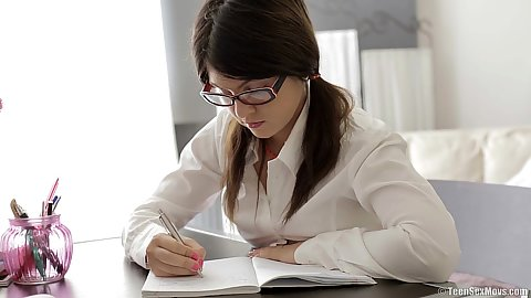 Dreamy 18 year old nerdy teen Mackenzie doing some homework and getting clothes taken off