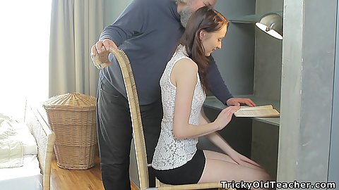 Skinny fully clothed 18 year old Alina is doing some homework when old man grandpa come along to touch her breasts