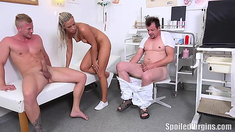 Doctor and bf share girlfriend Petra in doctors office and both unload a nice semen load on face and boobs
