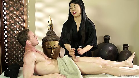 Nari Park is an asian massage girl but likes to jerk off her clients in cfnm