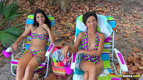 Two latina teen Ariana Cruz and Gina Valentina wearing sexy bathingsuits awaiting for someone to meet up