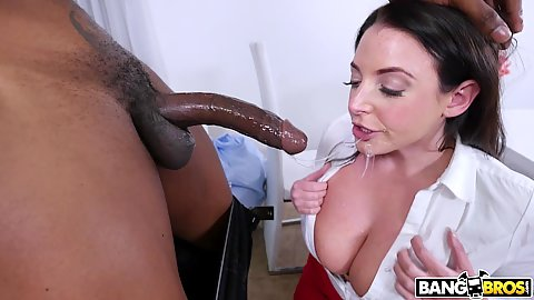Angela White slobbering and gagging on a massive black rocket with large cleavage hanging out