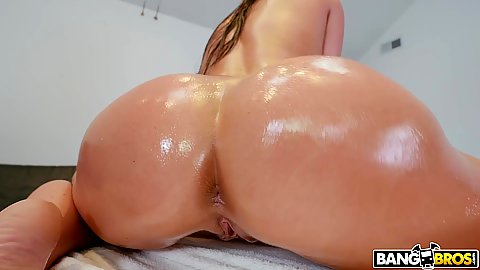 Oiled round butt on massage table with Angela White enjoying the proper massage