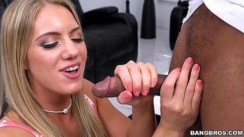 Candice Dare is giving a good tugjob to a large black dick while below it