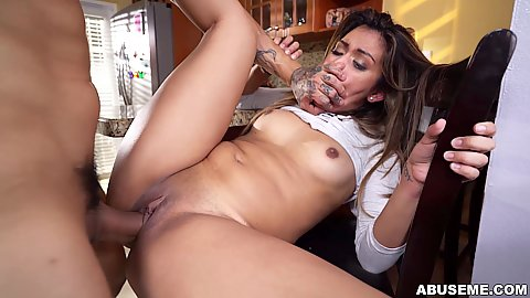 Criminal thief covering Nicole Rey mouth as she pounds her naughty pussy on kitchen chair