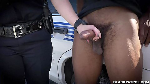 Female cops handjob and deep throat this hard and throbbing black shaft right behind the cop car in public Joslyn and Maggie Green