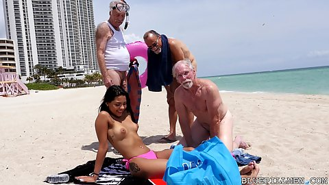Group of old men go to the beach find a young latina hottie Nikki Kay ask if they can rub her body with oil she agrees so they pick her up and invite her over