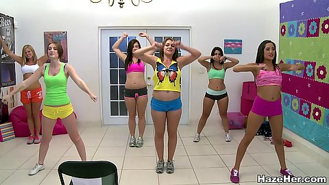 Sparkling wokout bitches at a college dorm doing some stretching wearing hotpants and showing off butts
