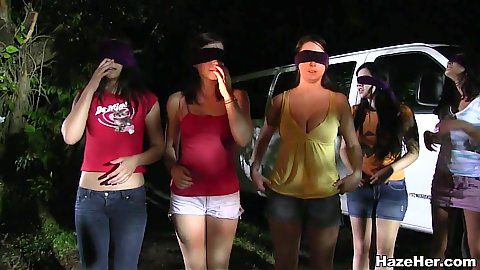 Night time awakening and hazing about to happen to these blind folded amateur chicks getting naked in a forest