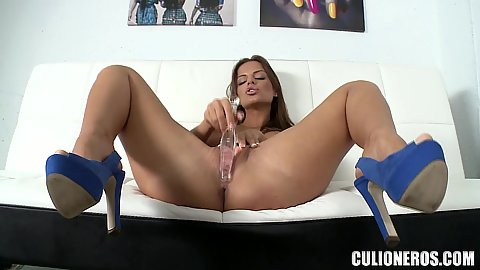 Self pussy banging with a sex toy from high heels wearing Black Angelika doing her first audition in our office
