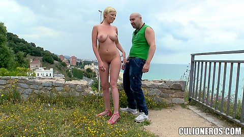 Naked chick Donna Bell jerking off guy outdoors on the public lookout spot and gets laid