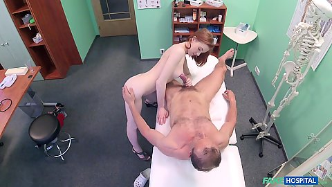 Fair skinned small body Russian redhead touches doctors penis and gets on top of it for a good hump