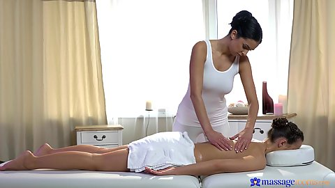 Two girls with on naked on massage table feeling the oily touch from her friend Kristy Black and Foxxi Black