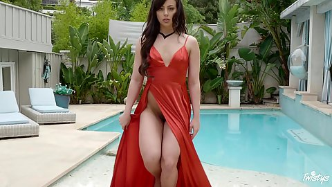 This good looking Whitney Wright wearing a dress over naked body with no bra and no underwear on having wind blow through her hair