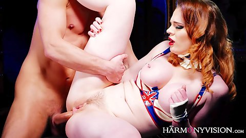 Pale skinned ginger haired Carly Rae ass penetrated from front and back while wearing latex outfit