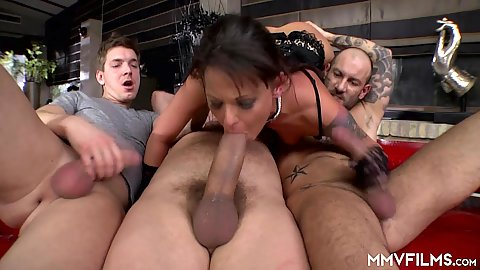 Three big dicks and a horny slut that must suck and fuck them all in 3 on 1 gang bang for lingerie brunette Simony Diamond