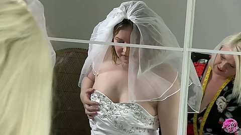 Future bride is assisted by our professional gilf Lacey Starr she gropes her when the wedding dress is on with Sahara Knite and Amber West
