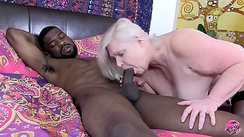 Gilf Lacey Starr wrapping her lips around a thick black meat on a younger male while she is so aged