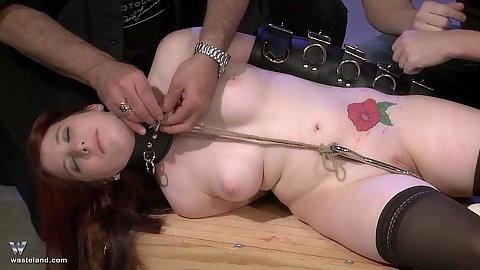 Red ass great spanking for a bruising butt with two male maasters and one redhead submissive girl in leather bondage sleeves and a hook