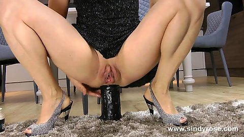 Super insane ass straching with monster dildo Sindy Rose sitting on it in a squatting position on the floor with outie pussy flapping outward
