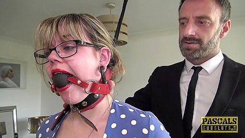 Glasses and ball gag wearing blonde big chested 23 year old Madison Stuart tied to a ceiling for a very submissive touching and punishment