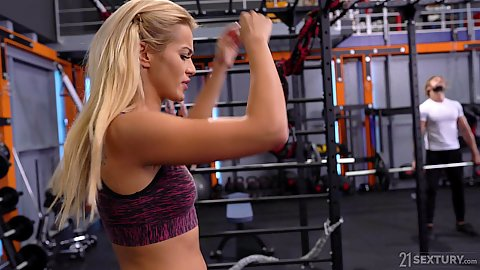 Blonde Cherry Kiss working out at the gym when her trainer approches her and starts to touch her