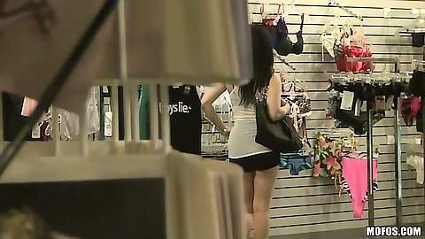 Chloe Caine going shopping and going to change room while pervert watches