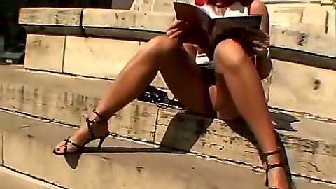 Outdoor upskirt posing in public on the euro streets with no panties with Melissa Lauren