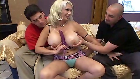 Huge tits milf works on two dicks at once