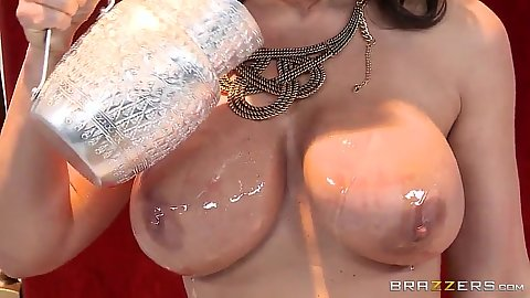 Oiling up her large milf boobs with Lisa Ann
